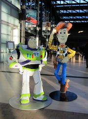 "Characters from the movie ""Toy Story"" -- Buzz Lightyear and Woody -- from Pixar, another Bay Area movie maker acquired by Disney."