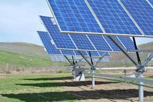 A QBotix solar robot adjusts giant solar panels on trackers at the Santa Rita Jail.