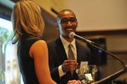 Lester Mackey accepts his 40 Under 40 award.