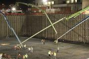 Four concrete pumps form the first section of the foundation during a 20-hour long pour in September 2011.