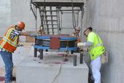 The first of 115 base isolators, designed to help the hospital survive a major earthquake by moving with its motion, were installed in early November.