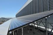 Row of solar panels near the top of the new San Francisco Public Utilities Commission building.