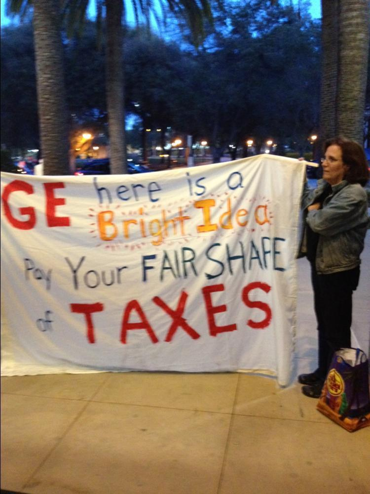 Occupy Stanford protestor Marguerite Young had a message for General Electric Chairman and CEO Jeffrey Immelt, who was the dinner speaker at the Stanford Institute for Economic Policy Research's economic summit March 9.