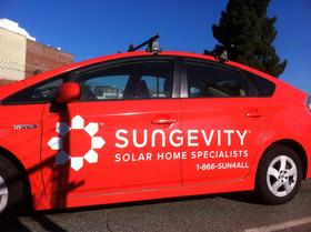 A car emblazoned with Sungevity's logo near its Jack London Square headquarters.