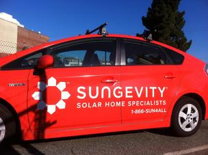 A car festooned with Sungevity's logo near its Jack London Square headquarters.