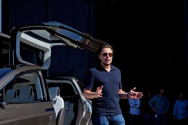 Tesla Motors co-founder Elon Musk with the forthcoming Tesla Model X SUV/minivan crossover electric vehicle.