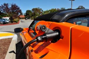 A Tesla Motors Roadster being charged.