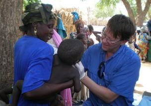 UCSF's Dr. Thomas Lietman treats a young child in Niger last year.
