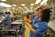 Sue Chen, production supervisor on Topcon's manufacturing floor, where workers assemble global positioning satellite signal antennas, lasers, inertial sensors and equipment mounts.