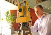 Ray O'Connor, president of Topcon Positioning Co., with a robotic surveying laser.