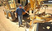 Derek Madrid, a Topcon training manager, teaches people how to let the machines do all the work.