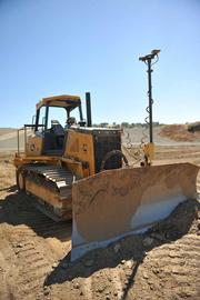 The GPS antenna on this dozer - which can be removed at the end of the day for safekeeping - is augmented with inertial sensors.