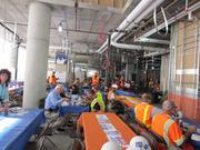 Workers and others eat a celebratory lunch at the topping off of tower two at Trinity Plaza in San Francisco.