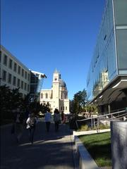 USF's new Lo Schiavo Center for Science and Innovation on the right, reflecting the landmark St. Ignatius Church.