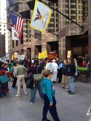 After protesting at the Wells Fargo annual meeting for much of the day, Occupy protesters shifted their attention to Bank of America and its May 9 annual meeting in Charlotte, N.C.