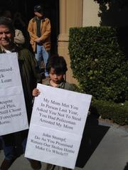 Donna and Nuno Vieira's 7-year-old son Leonardo joined his parents in carrying a placard discussing the family's experience in losing a second home in Reno, Nev., through a Wells Fargo foreclosure. They were part of a protest at Wells Fargo CEO John Stumpf's San Francisco home. Leonardo's mom was among those arrested at last year's Wells Fargo annual meeting, where some unsuccessfully sought a foreclosure moratorium.