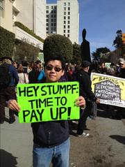James Lee, a member of Occupy Redwood City, was among those protesting over foreclosures in front of Wells Fargo CEO John Stumpf's San Francisco home Saturday.