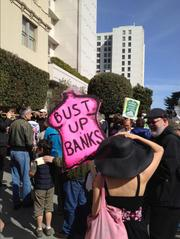Occupy protestors gathered in front of Wells Fargo Chairman and CEO John Stump's San Francisco home to deliver their own version of a foreclosure notice.