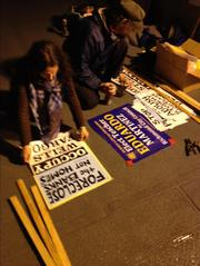 At 10 p.m. Monday, Occupy Wells Fargo protesters prepared signs for the demonstration that's expected to draw thousands of protesters to the bank's annual meeting Tuesday in San Francisco.