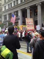Protesters demonstrate outside Wells Fargo's annual meeting.
