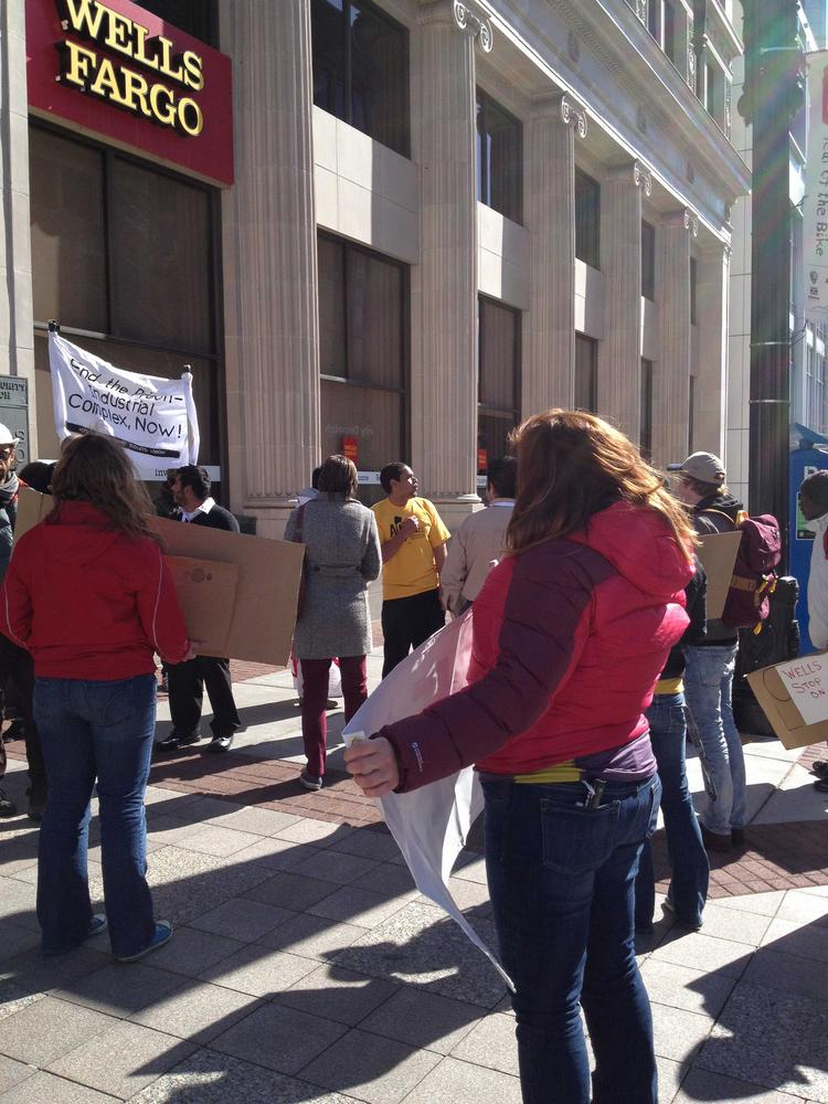Wells Fargo protesters gather around bank branches in Salt Lake City after interrupting the annual bank meeting held at a local hotel.