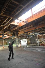 Bryon Benton, training director for the Alameda County Electrical Joint Apprenticeship and Training Committee, points to a roof monitor that will channel sunlight to warm a section of the concrete floor. That heat will then be transferred to other parts of the building.