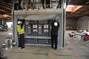 Drew Radachy of Novo Construction and Bryon Benton of the Alameda County Electrical Joint Apprenticeship and Training Committee, exhibit monitors that will keep track of how much wind energy the building is producing in real time.