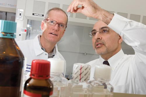 "3-V Biosciences CEO Dr. Merdad Parsey (right), with chemist Russ Johnson Sr. in a 2010 photo: ""It hasn't been easy."""