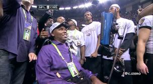 ALS patient and former Baltimore Ravens player O.J. Brigance on the field after the team's Super Bowl win over the San Francisco 49ers.