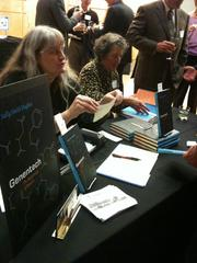 "Sally Smith Hughes, right at table, at a reception for her new book, ""Genentech: The Beginnings of Biotech."""