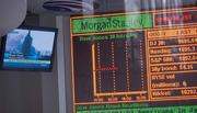 Sept. 11, 12:46 p.m.: A news monitor shows a replay of the World Trade Center attack, and the condition of the nation's money markets, at a Morgan Stanley market chart within the company's closed office in San Francisco. The company had 3,500 employees working at the World Trade Center complex.