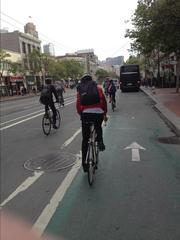 Bikes and cars merge on Market Street during Bike to Work Day.