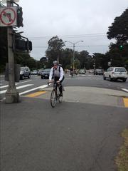 Bicyclists enter the Panhandle from Golden Gate Park as part of Bike to Work Day.