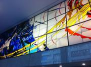 A backlit mural in the lobby of 2101 Webster.