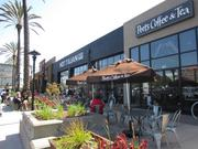 The existing retail in the Emeryville Public Market will be retained as part of the redevelopment project of the entire 14-acre site. The food court and restaurants are a popular lunch attraction.