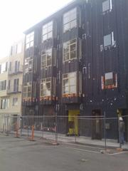 The outside of 38 Harriet is still covered in construction materials. It is a few weeks away from completion.