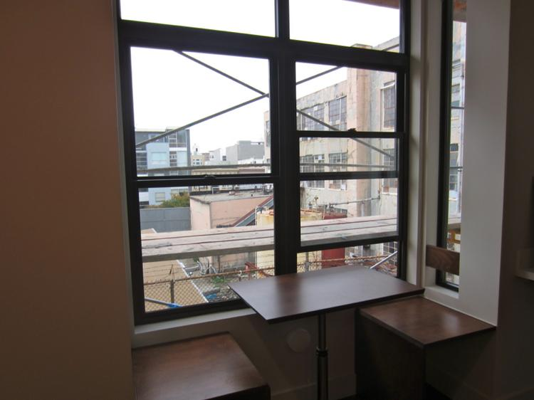 Each unit features a single window at the back where dwellers can set up a table or seating area.