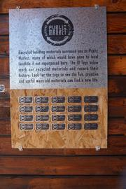 This plaque lists the variety of reused materials at the Public Market.