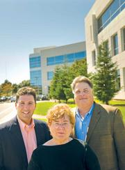 Best steal: SunEdison headquarters Belmont officials, including council member Coralin Feierback (center), Thomas Fil (left) and Carlos De Melo, lured SunEdison from Maryland with state tax credits and permit fee waivers.