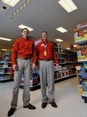 Stephen Brinkley (left), Target group vice president, stands alongside San Francisco City Target's store manager Brian Jess.