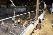 The slap mat is held down by 100-foot deep piles.