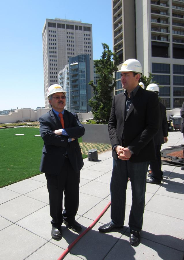 Mayor Ed Lee and Ali Rowghani, chief financial officer of Twitter Inc., on the roof deck of Twitter's new Mid-Market headquarters.