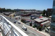 The view from the fourth floor of the EmeryStation Greenway building includes Bay Street, a retail and housing district in Emeryville.
