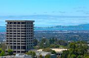 CSU East Bay plans to demolish the 13-story Warren Hall, a well-known structure that is seismically unsafe, to make room for a new 4-story office building. The demolition will also carve out better views of the Bay from the campus.