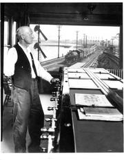 A one-armed towerman photographed in the control tower in 1925.