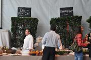Chefs set up stands side-by-side.