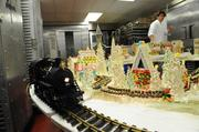 A dry run: the train chugging around the assembled sugar village in the Westin St. Francis pastry kitchen. The St. Francis has the largest pastry kitchen in San Francisco.