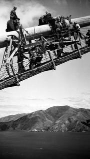 The Golden Gate Bridge during construction, as photographed by Standard Oil Company of California (now Chevron) public relations employee Ted Huggins.