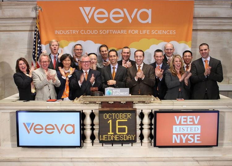 Veeva founder and CEO Peter Gassner and entourage ring the bell on the New York Stock Exchange.