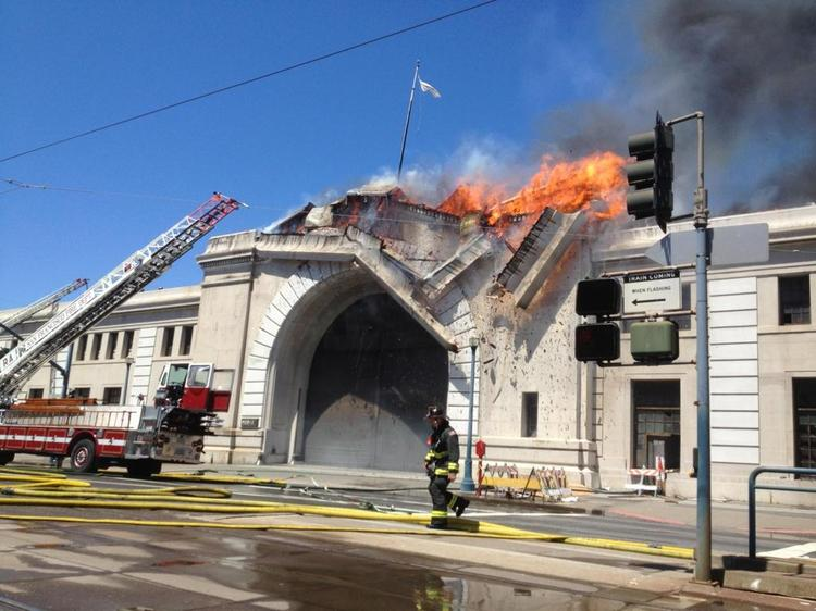A roof line collapses Wednesday afternoon at Pier 29.